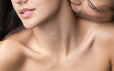 Man gently kissing naked beautiful woman on neck erogenous zone, closeup view