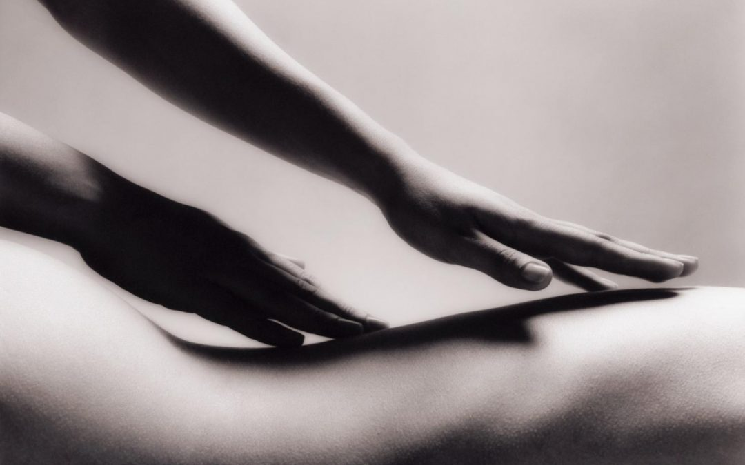 naked back being massaged by woman