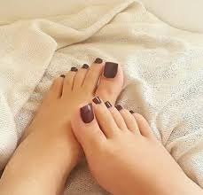 pair of pretty feet for foot massage